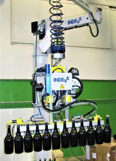 Handling wine bottles by means of a manipulator complete with a vacuum gripper