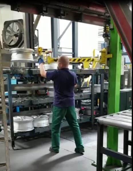 INDEVA Linear Manipulator for stocking tire rims deep onto shelves